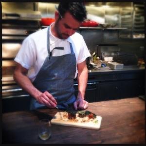 Chef Ryan Pollnow plates a taste of mushrooms.