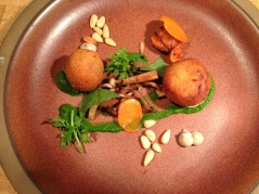 Crispy trotter with carrot, beech mushrooms, pinenuts, & lava leaves.