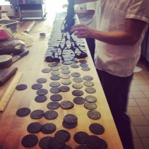 Making squid ink corzetti in the dough room.
