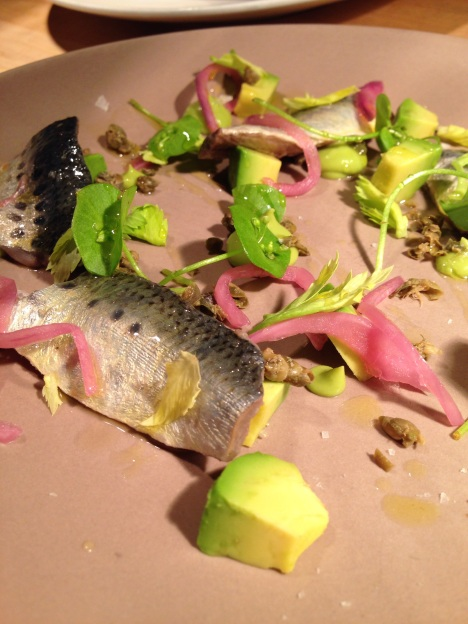 Cured sardines with pickled red onion, avocado, celery & capers.